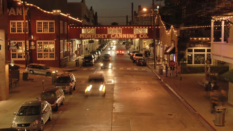 Night time lapse of tourists on historic Cannery Row in Monterey, California Footage
