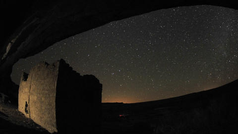 Zoom out time lapse of star trails above a Chacoan rock house in Gallo Wash in Chaco Culture Nationa Footage