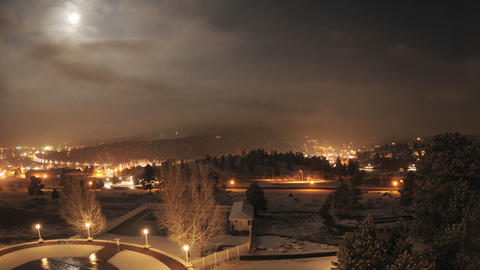 Night time lapse of a snowstorm in Rocky Mountain National Park from the Stanley Hotel in Estes Park Footage
