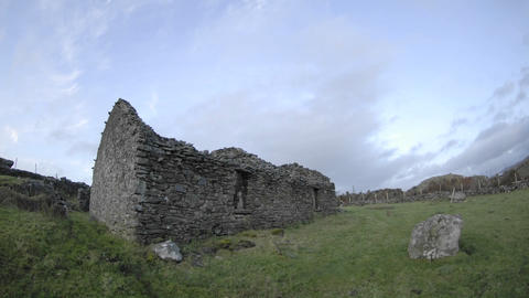 Time lapse of clouds blowing over the ruins in Glencolumbkille, County Donegal, Ireland Footage