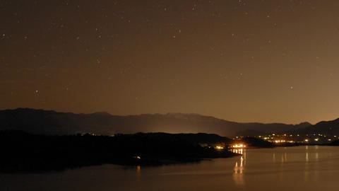 Night time lapse of clouds and stars over Lake Casitas in Oak View, California Footage