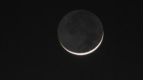 Time lapse of a waxing cresent moon setting in Oak View,... Stock Video Footage