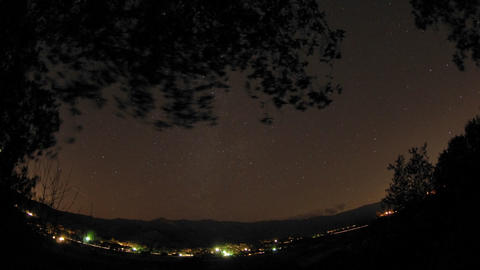 Night time lapse of startrails below an oak tree above Oak View, California Footage