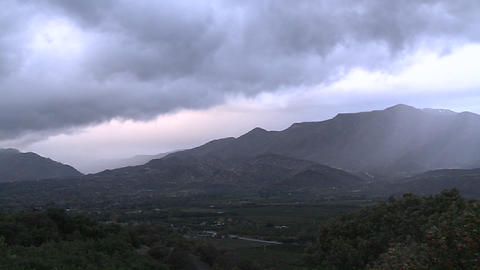 Time lapse of a snowstorm clearing over the Ojai Valley, California Footage