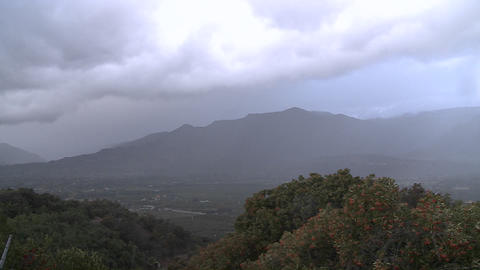 Time lapse of a snowstorm and sunshine over the Ojai Valley, California Footage