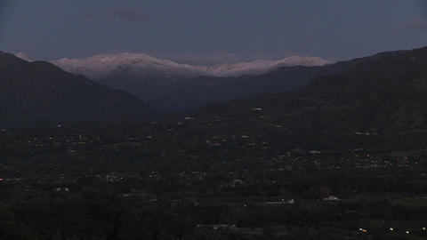 Time lapse of sunrise after a snowstorm above Ojai,... Stock Video Footage