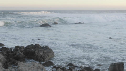 Time lapse of waves breaking on the rocks at Point Pinos at sunrise in Pacific Grove, California Footage