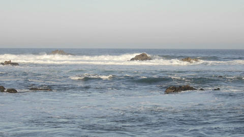 Variable time lapse of waves breaking on the rocks at Point Pinos in Pacific Grove, California Footage