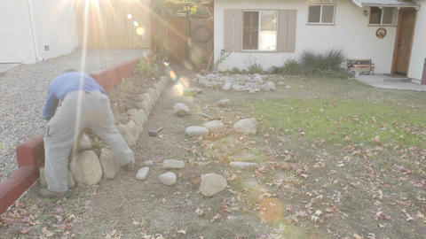 Time lapse of a man building a rock wall in Oak View, California Footage