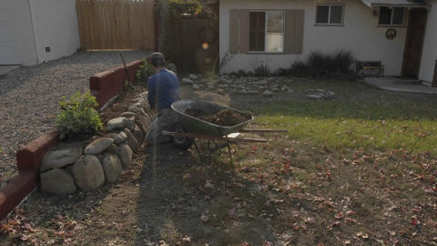 Time lapse of a man building a rock wall in Oak View,... Stock Video Footage