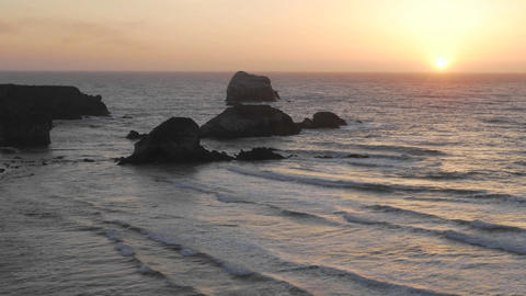 Time lapse of sun setting over the Pacific Ocean at Sand Dollar Beach in Big Sur, California Footage