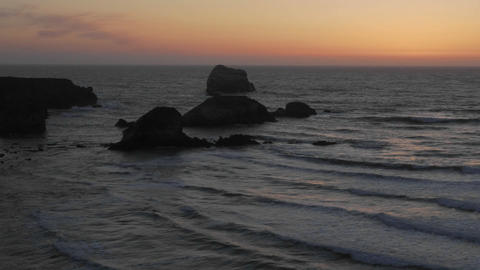 Time lapse of sun setting over the Pacific Ocean at Sand... Stock Video Footage