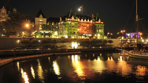 Night time lapse of the Fairmont Empress Hotel and Victoria Harbour on Vancouver Island in British C Footage