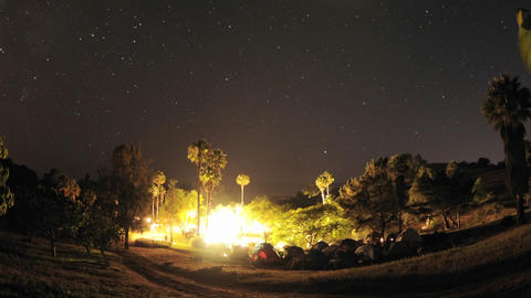 Zoom out of night time lapse of a wedding campout in... Stock Video Footage