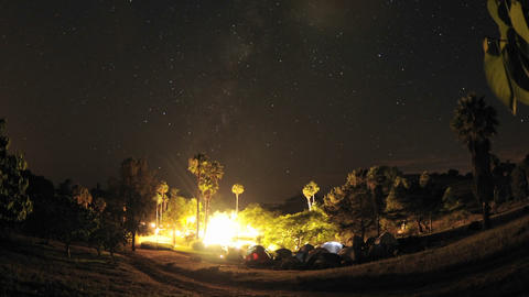 Zoom out of night time lapse of a wedding campout in Gaviota, California Footage