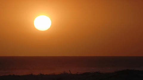 Close-up time lapse of sun setting over the Pacific Ocean... Stock Video Footage