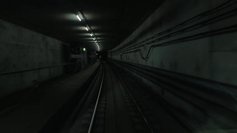 Cabin view of train moving in dark subway tunnel Footage