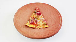 Piece of pizza rotation on wooden plate GIF