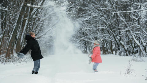 Children Playing With Snow in the Park Footage