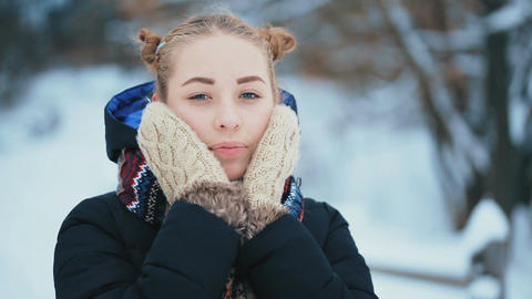 Young Woman With Blue Eyes in Winter GIF