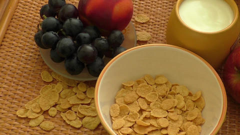 Falling milk on corn flakes. Healthy food Live Action