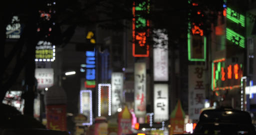 Advertising banners and car traffic in night Seoul, South Korea Live Action
