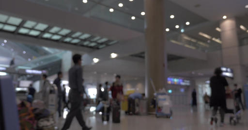 People with baggage and carts in airport terminal Footage