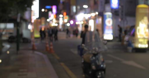 Street with illuminated store banners at night in Seoul, South Korea Footage