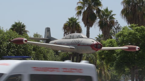 Old military airplane exposed as a monument in a city, Motril, Spain Live Action