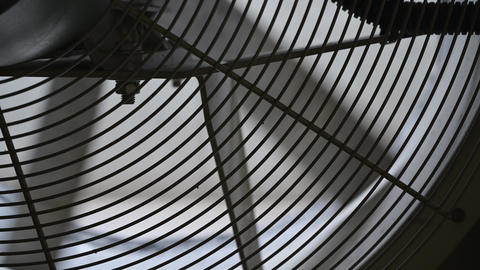 A close-up of the rotating blades of an industrial fan. Industrial ventilation system Live Action