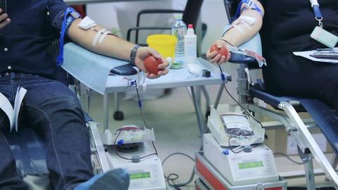 Male volunteers donate blood Footage
