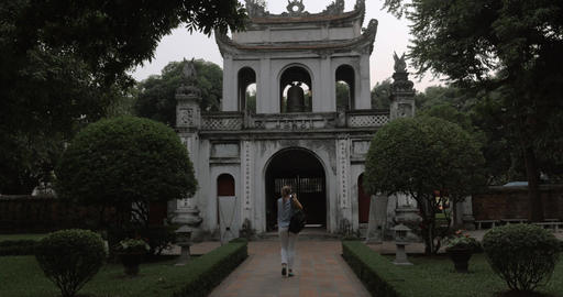Tourist shooting Temple of Literature main gate. Hanoi, Vietnam Footage