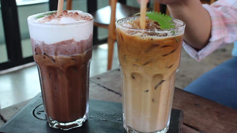 Mixed cold milk coffee with straw Live Action