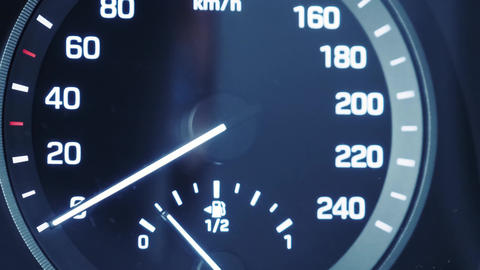 Car dashboard in close-up. illuminated car tachometer with close-up icons. Car interior Live Action