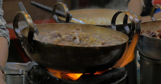 On open fire in cauldrons cooking east asian cuisine Footage