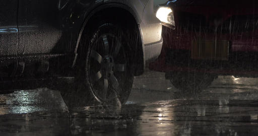 Parked cars under the rain at night Footage