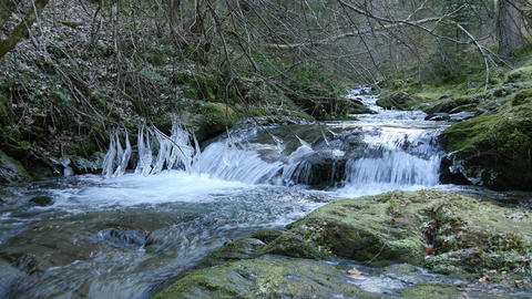 Icicles Over Beautiful Mountain Stream Flow Footage