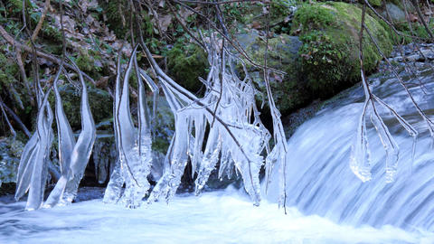 Icicles Over The Mountain Stream Flow Footage