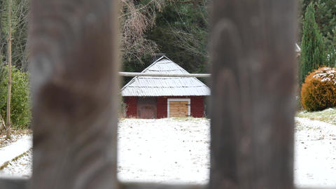 Cottage and windy snowy day slow motion Footage