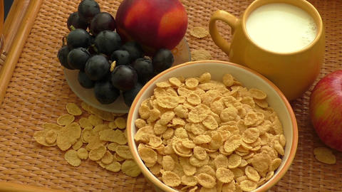 Cornflakes in a bowl with milk and fruits Footage