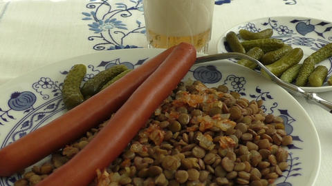 Cooked lentil with spicy sausages and pickles Footage