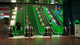 Adult woman walk out from escalator, underground metro entrance Footage