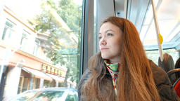 Woman look out tram window, coach begin to move, bright... Stock Video Footage