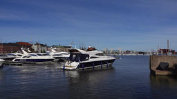 Luxury recreational motorboat sail away from marina, group go for day journey Footage