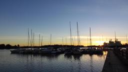 First sun ray break over horizon, nice sunrise at yacht marina, many boats Footage