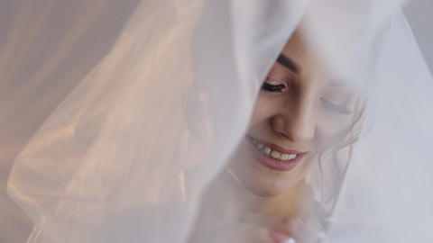 Bride in boudoir dress under veil and in a silk robe. Wedding morning Live Action