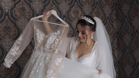 Bride in lingerie is spinning in dance with her wedding dress. White boudoir Live Action