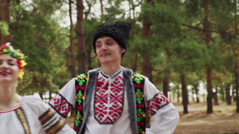 Close up of couple in traditional costumes are dancing Ukrainian national dances Live Action