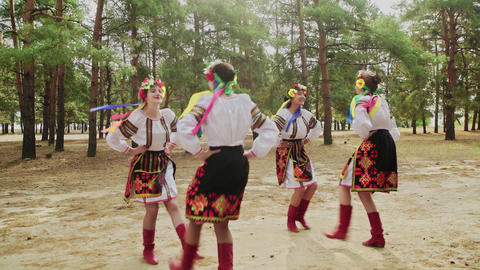 Young women in traditional costumes are dancing Ukrainian national dances Live Action