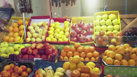 A lot of fruits and berries at the counter at the market Live Action